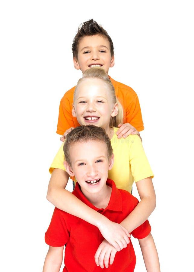 Portrait des enfants heureux d'isolement sur le blanc image libre de droits