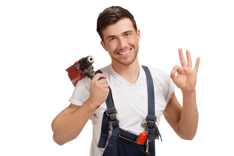 Portrait des glücklichen jungen Heimwerkers mit Hilfsmittel lizenzfreie stockfotos