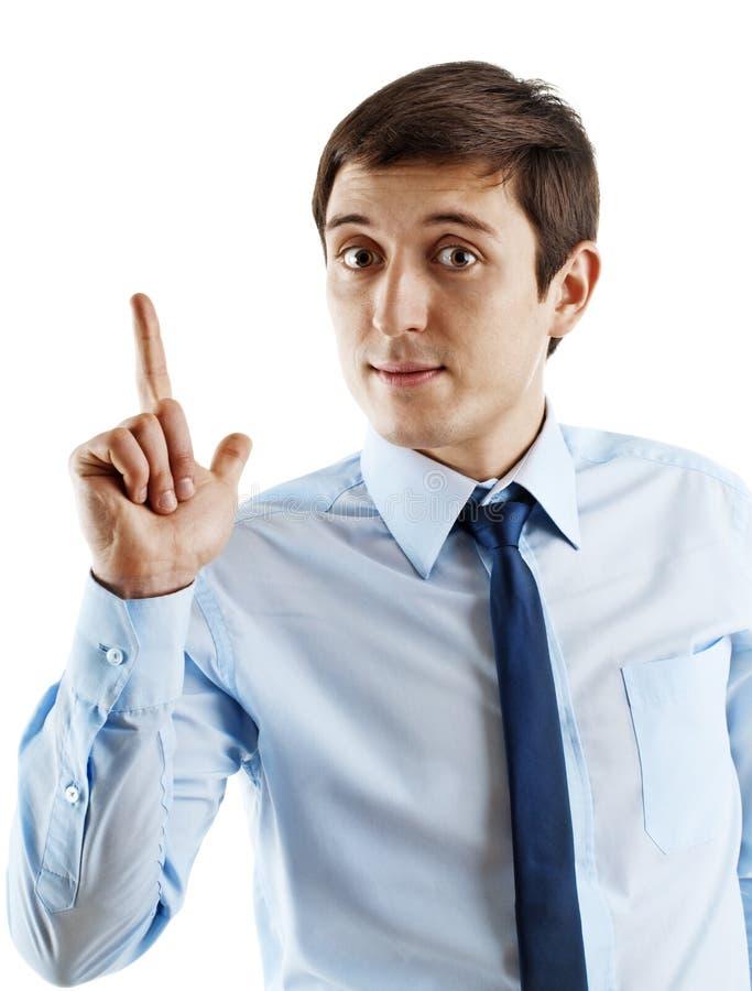 Portrait des jungen Geschäftsmannes, der oben zeigt stockfotografie