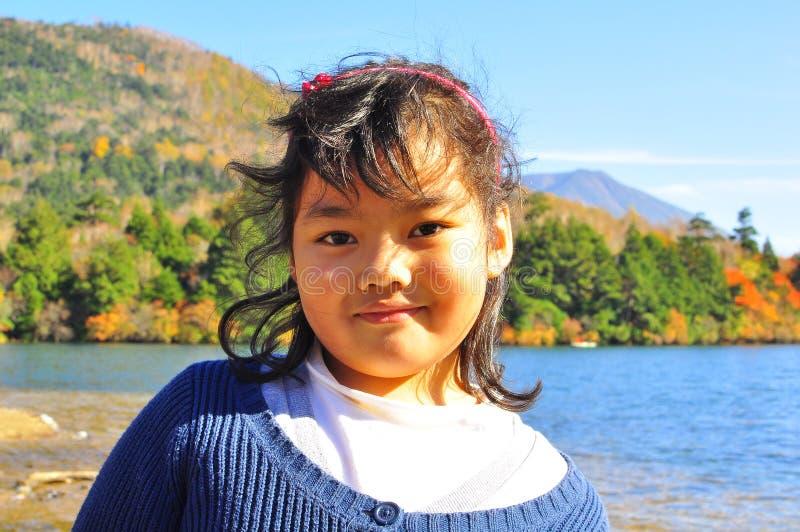 Portrait des a-lächelnden malaysischen Kindes stockbild