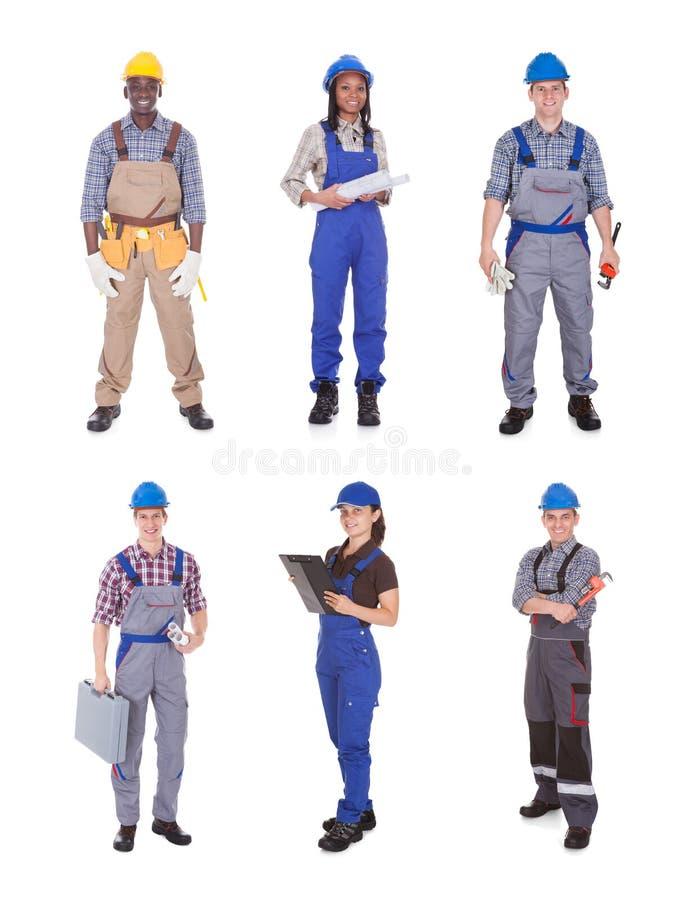 Portrait des travailleurs manuels sûrs image libre de droits
