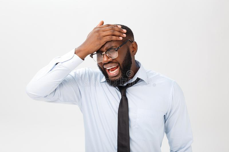 Portrait of desperate annoyed black male screaming in rage and anger tearing his hair out while feeling furious and mad. With something. Negative human face royalty free stock images