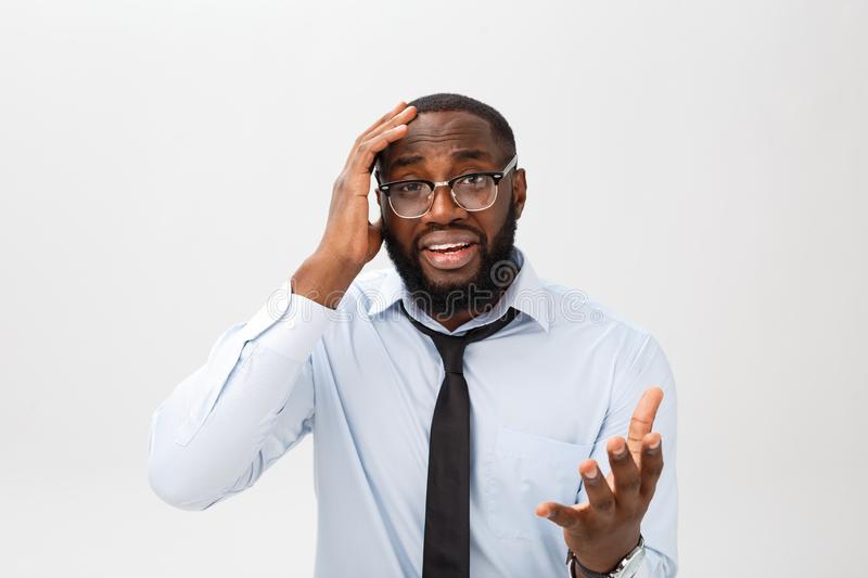 Portrait of desperate annoyed black male screaming in rage and anger tearing his hair out while feeling furious and mad royalty free stock images