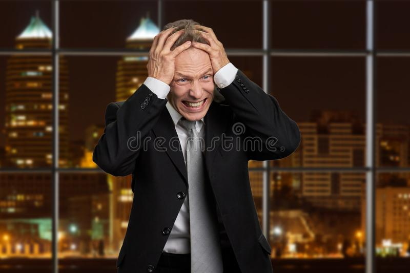 Portrait of desperate mature businessman. royalty free stock image