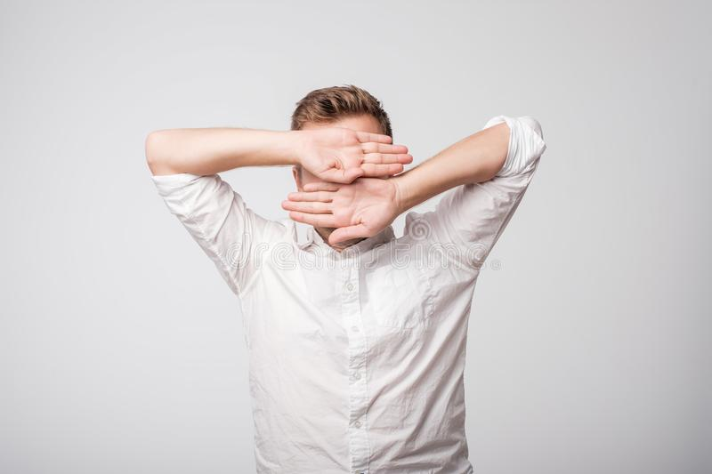 Portrait of desperate sad caucasian man hiding his face. Concept of being guilty stock photos
