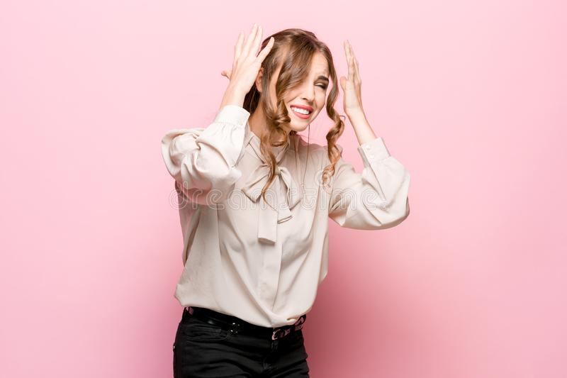 Portrait of displeased upset female frowns face as going to cry. Being discontent and unhappy as cant achieve goals, over pink studio background. Dissapointed stock images
