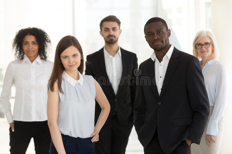 Portrait of diverse confident work team looking at camera stock images