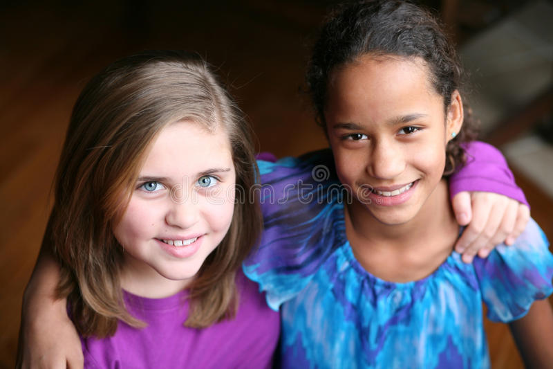 Portrait of diverse preteen girls smiling royalty free stock photo