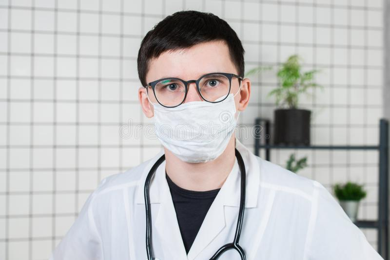 Portrait of doctor, face close-up in medical mask. Copy space stock photography