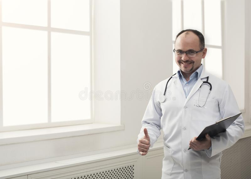Portrait of doctor in glasses in his office royalty free stock photo