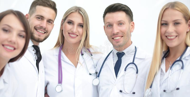 Portrait of smiling medical team. Portrait of a doctor and medical team on white background stock photo