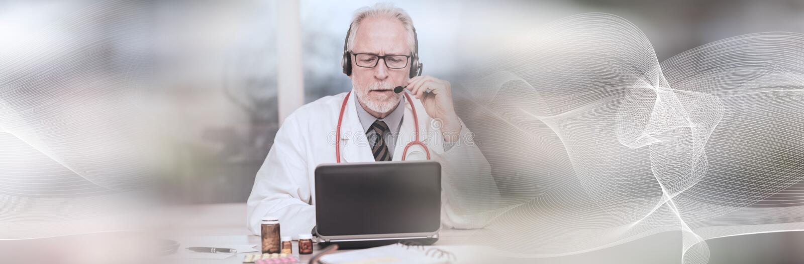 Portrait of doctor during online medical consultation; panoramic banner. Portrait of senior doctor during online medical consultation; panoramic banner stock photos