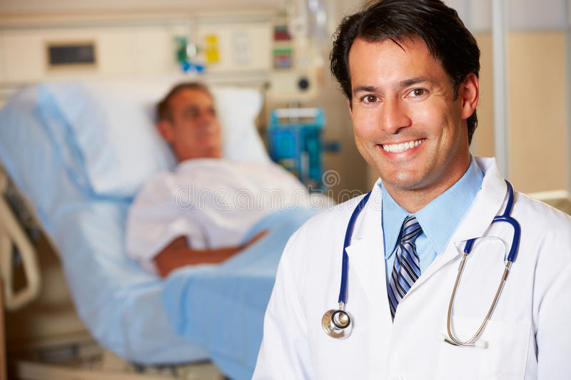 Portrait Of Doctor With Patient In Background Stock Photography
