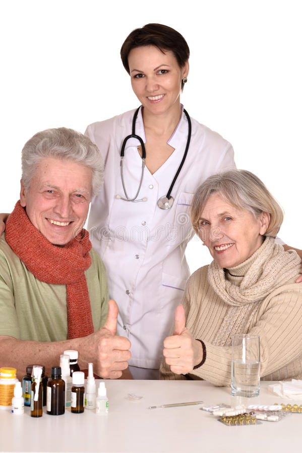Portrait of doctor and sick older caucasian couple. Over white background stock image