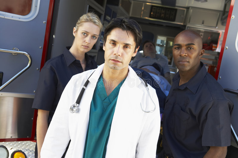 Download Portrait Of Doctor With Two Paramedics Royalty Free Stock Photography - Image: 9003627
