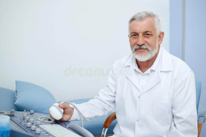 Portrait of doctor in white uniform in hospital. stock photo