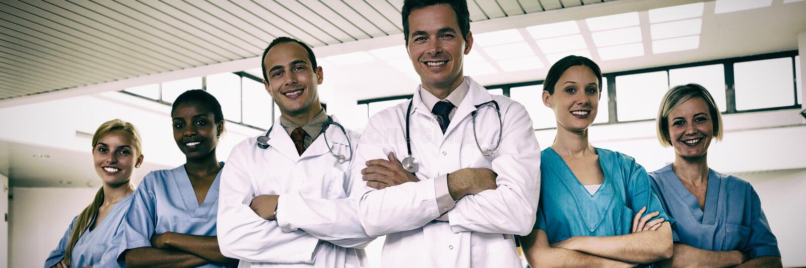 Portrait of doctors and nurses with arms crossed stock image