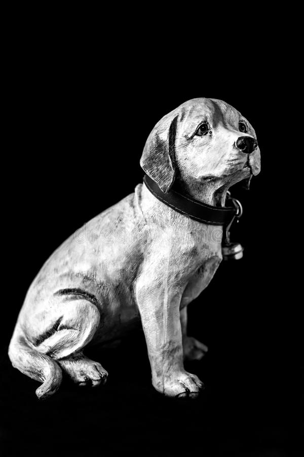 Portrait of a dog sculpture on a black background, whole body. Black and white stock images