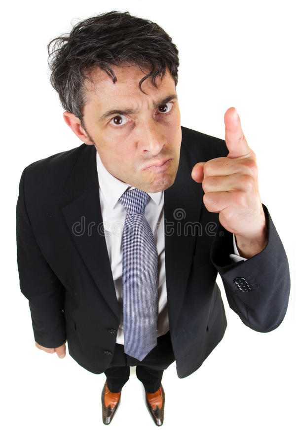 Portrait of a dogmatic businessman. Humorous high angle portrait of a dogmatic businessman glaring at the camera and pointing his finger as he stresses his royalty free stock photography