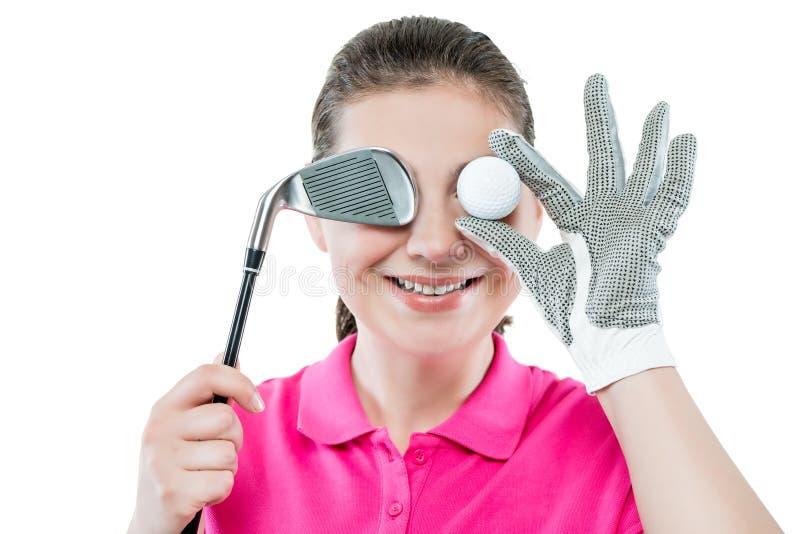 Portrait drôle des golfeurs heureux avec une boule d'oeil d'isolement images stock