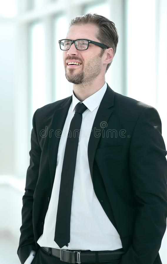 Portrait of a dreaming businessman near the office window stock photography