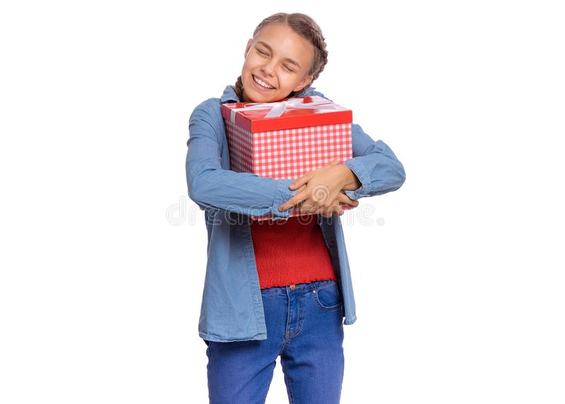 Teen girl holding red gift box royalty free stock images