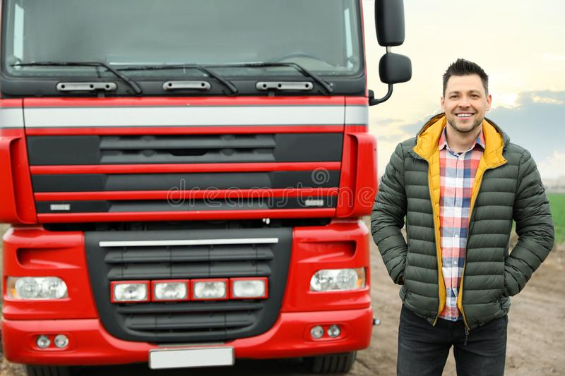 Portrait of driver at modern truck. Outdoors royalty free stock photos