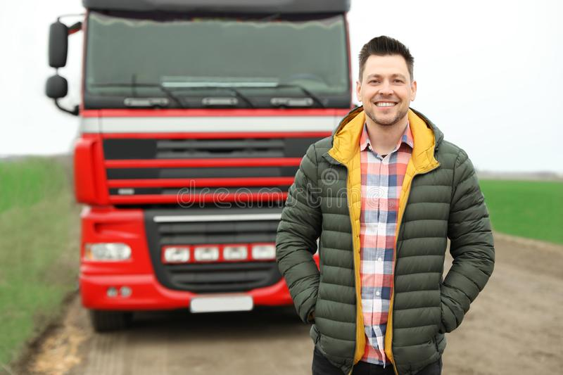 Portrait of driver at modern truck. Outdoors royalty free stock photography