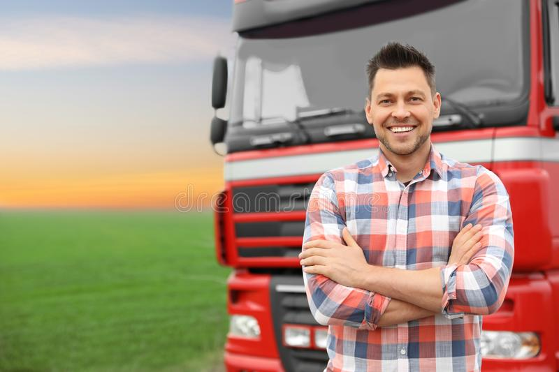 Portrait of driver at modern truck outdoors. Space for text royalty free stock photography
