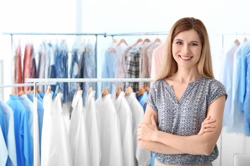 Portrait of dry-cleaner`s employee. At workplace royalty free stock photo