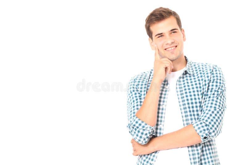 Portrait du jeune homme de sourire futé se tenant sur le fond blanc Copiez l'espace Voir les mes autres travaux dans le portfolio images libres de droits