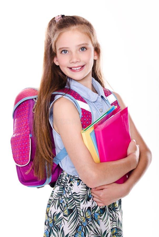 Portrait du sourire mignon heureux petit adolescent d'enfant de fille d'?cole avec le sac ? dos et les livres de sac d'?cole d'is photo libre de droits