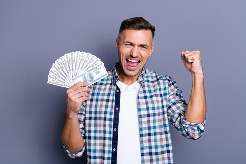 Portrait of ecstatic lucky man raise fists scream shout yeah have achievements aims champion casino triumph wages royalty free stock photography
