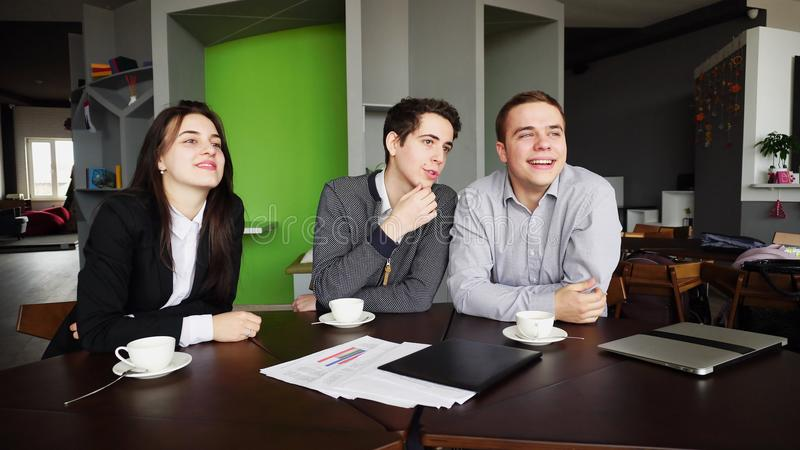 Portrait of educated students of guys and girls who communicate royalty free stock image