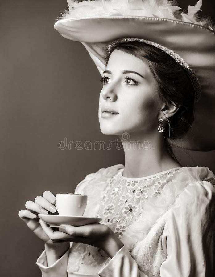 Edvardian woman with cup on red background. Portrait of edvardian woman with cup on red background royalty free stock photos