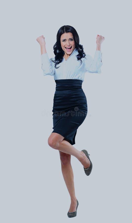 Portrait einer attraktiven Geschäftsfrau mit ihren Armen hob in Feier an lizenzfreie stockfotos