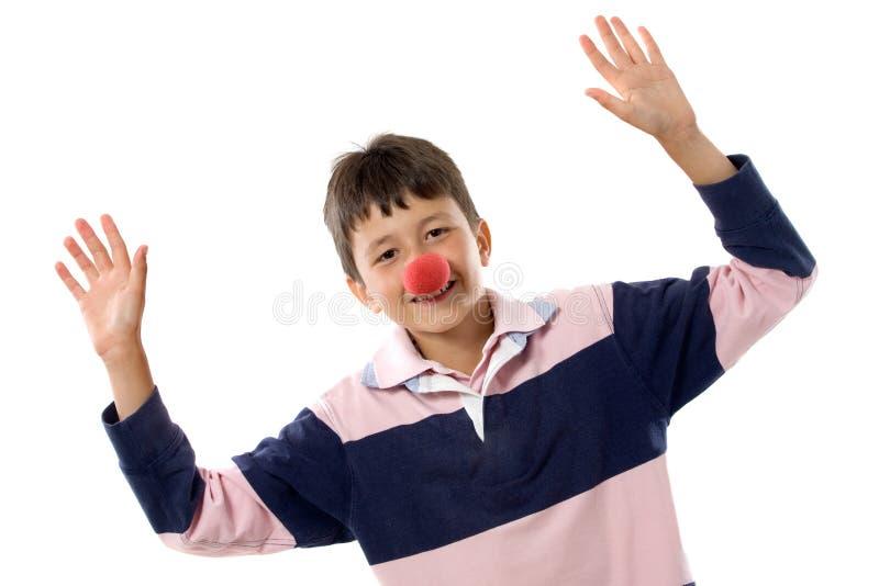 Portrait eines entzückenden Kindes mit einer Clownwekzeugspritze lizenzfreie stockfotos
