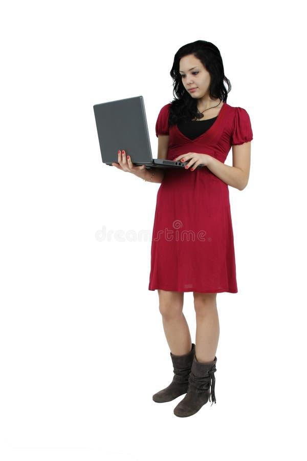 Portrait eines glücklichen jungen Mädchens mit Laptop stockfotos