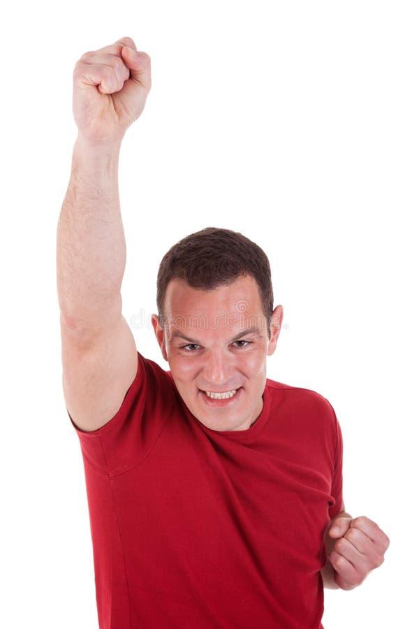 Portrait eines glücklichen Mannes mit seinem Arm angehoben lizenzfreie stockfotografie