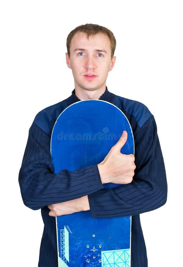 Portrait eines Jungen in der Sportkleidung mit Snowboard stockfotografie