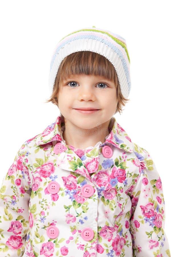 Portrait eines reizend kleinen Mädchens in einer Schutzkappe lizenzfreies stockbild