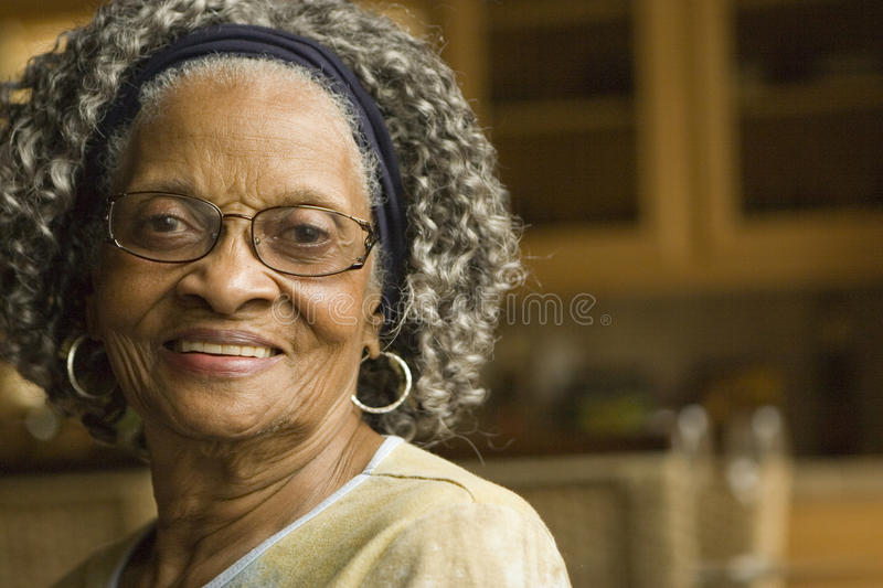 Portrait of an elderly African American woman at home. royalty free stock images