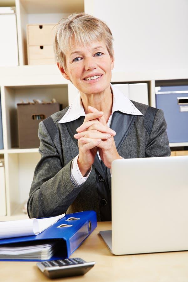 Portrait of elderly business woman