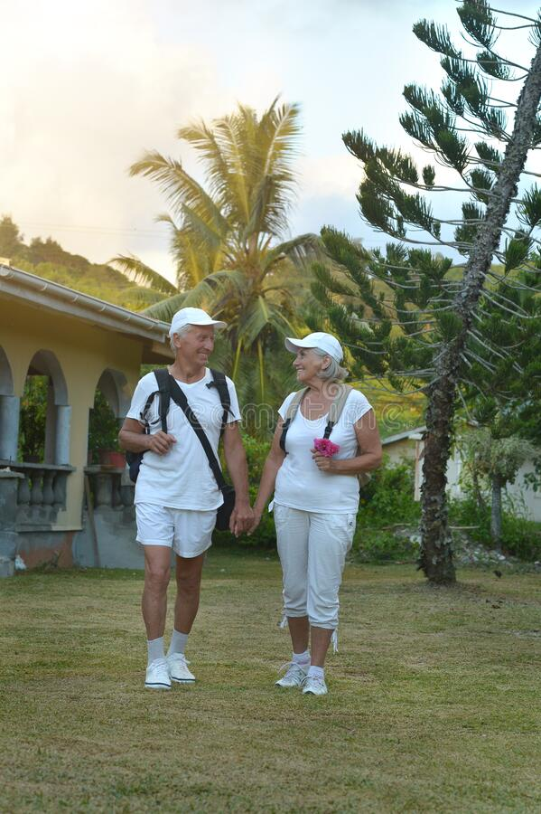 Portrait of elderly couple of backpackers. Travel stock images