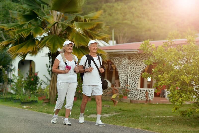 Portrait of elderly couple of backpackers. Travel royalty free stock photography