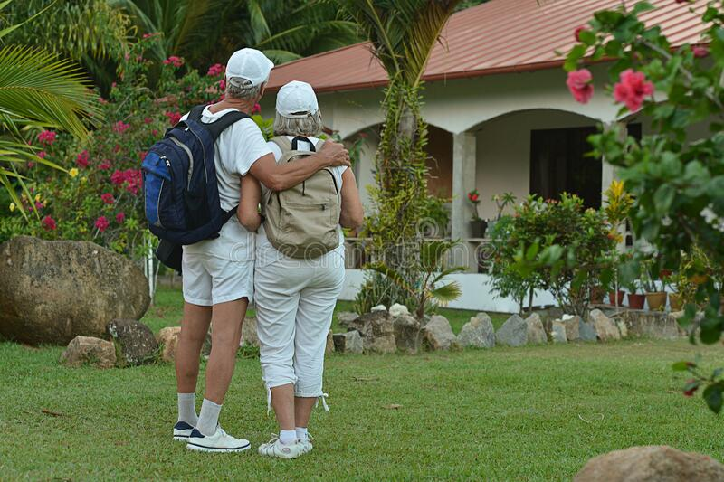 Portrait of elderly couple of backpackers. Travel stock photography