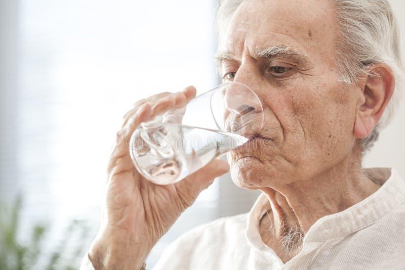 Portrait elderly man drinking water royalty free stock image