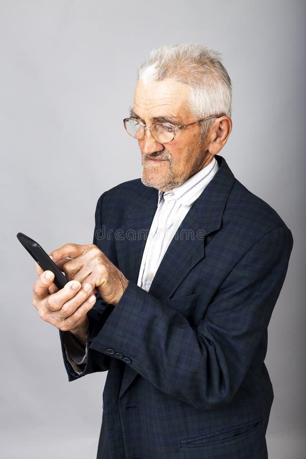 Portrait of an elderly man using mobil phone stock photo