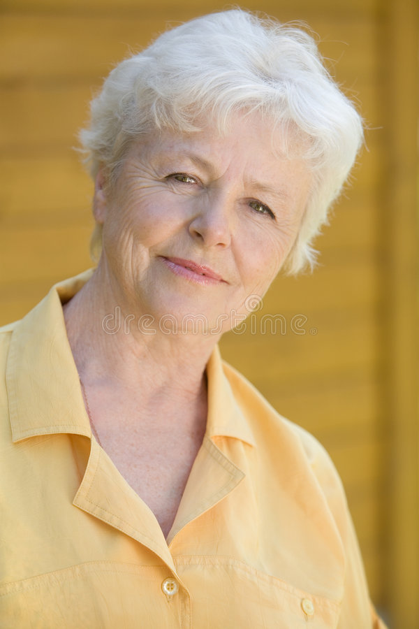 Portrait of the elderly woman. Portrait of the elderly smiling woman stock images