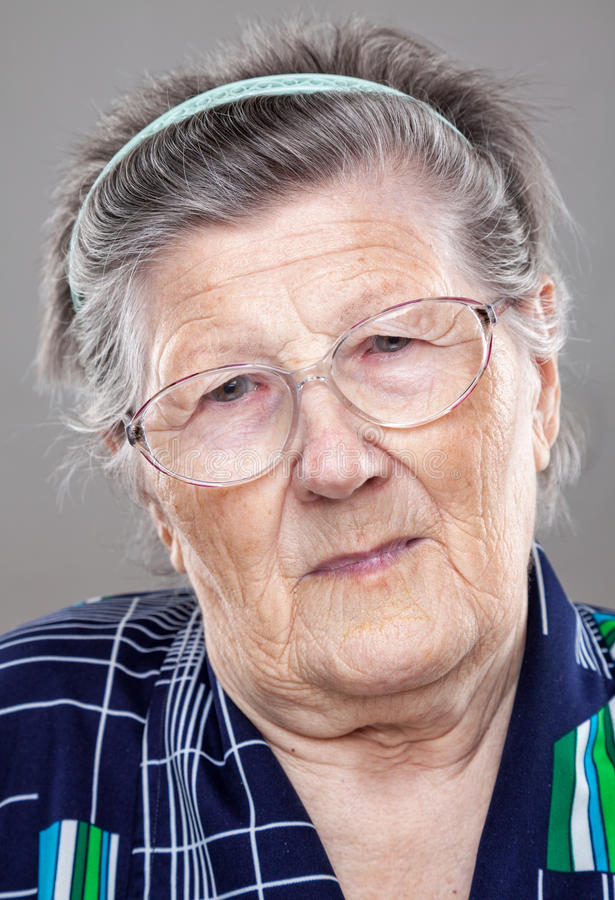 Portrait of an elderly woman royalty free stock photos